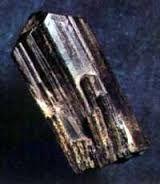 Ilvaite.Colour:Iron-black, dark grayish black . Hardness (Mohs):5½ - 6.Type Locality:Torre di Rio - Santa Filomena area (Monte della Torre), Rio Marina, Elba Island, Livorno Province, Tuscany, Italy.