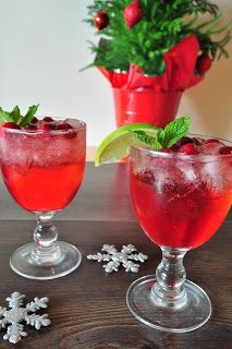 Cranberry juice, ginger ale and vodka Garnish with mint, lime and frozen cranberries