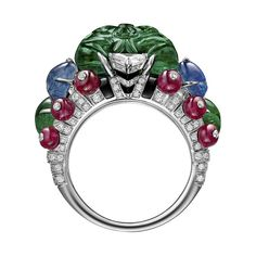 Carved emerald, emerald cabochons, sapphires, rubies, diamonds and platinum. An important ring by Cartier.