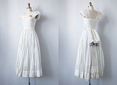 Detail inspiration - 1940s bustle wedding gown, love the touch of colour on the bustle - could also use flowers on the bustle