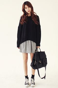 Skirt with oversized sweater. High socks with converse.