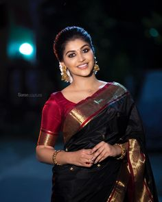 In a gorgeous black color pattu / kanjeevaram saree with butti, red color elbow length sleeve blouse design, necklace and jewelry Wedding Saree Blouse Designs, Silk Saree Blouse Designs, Blouse Back Neck Designs, Sari Bluse, Indische Sarees, Simple Sarees, Saree Trends, Saree Models, Indian Bridal Fashion