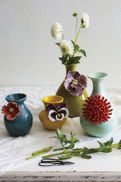 Anthro Curvy Chrysanthemum Vase and Friends! These are so beautiful. I would love to have all of them to display.