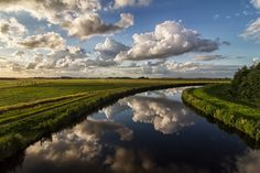 Ostfriesland - Photography by Günther Assing 500px.com-photo-75279593 #clouds #river #reflection