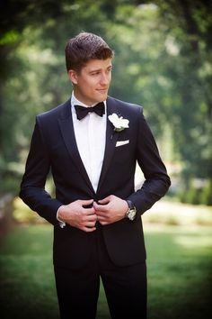 Alexandra and Drew's Wedding in Atlanta, Georgia Classic groom outfit idea – black tuxedo with black bow tie + white boutonniere {Kristen Alexander Photography} Black Tuxedo Wedding, Black And White Tuxedo, Groom Tuxedo Wedding, Mens Wedding Tux, Black Suits, Black Tuxedos, Wedding White, Groomsmen Tuxedos Black, Black On Black Suit