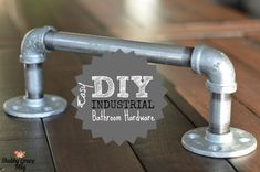Since we remodeled our 1/2 Bathroom, I also wanted to update our hardware. Because it's a 1/2 bath, I only needed a toilet paper holder and a small hand towel holder. I've always been crushin' on the industrial / galvanized piping look. I ALMOST bought them online. Then it dawned …