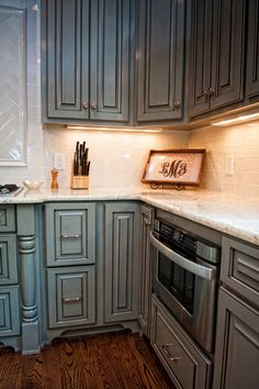 Beautiful cabinets with the white tiles & counter tops.
