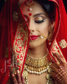 Editorial photo shoot by JSK Photography. Traditional red lengha. Indian bride model. Nose ring. bridal jewelry