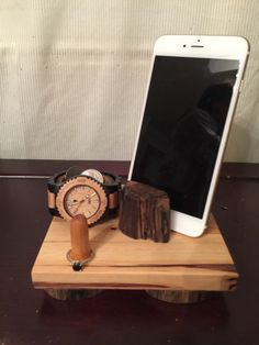 A personal favorite from my Etsy shop https://www.etsy.com/listing/258904346/driftwood-cellphone-docking-station-ring
