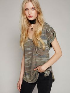 Camo Tee | Perfectly slouchy tomboy tee with a cute camo print. Features a…