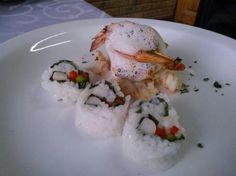 Stater of Grilled prawn served with basmati ala sushi drizzled with wasabi foam