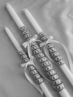 "white and gold metallic wrapped baptismal candle set includes  one 21"" lambatha and two 17"" candles  ​ the candles are used for the sacrament of baptism in the Eastern Orthodox churches, including Greek, Bulgarian, Serbian, Russian, Ukrainian, Antiochian and Romanian"