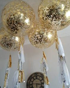 """Gold, silver and white giant confetti tassle balloons"