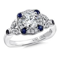 Put as many stars in her eyes as there are in the sky. | Diamond and blue sapphire halo engagement ring mounting with side stones set in 14k white gold. | Valina Bridals