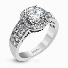 With a beautiful halo surrounding the center stone, this lovely white gold engagement ring is set with 1.14 ctw of shimmering princess cut white diamonds and .20 ctw round cut white diamonds. Print Page