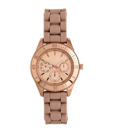 Beige. Metal watch with a silicone strap, decorative dials on face, and luminous…