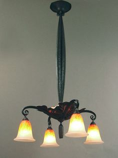 An Elegant French Art Deco Wrought Iron Chandelier with Schneider Shades & Mica image 3