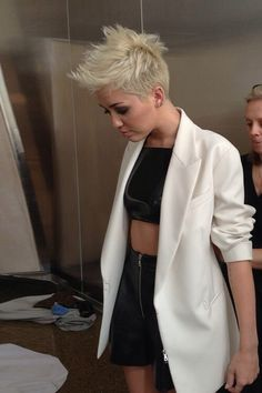Miley Cyrus blond undercut and dressed in black and white