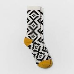 Give your collection of socks a lively update with the Fair Isle Crew Boot Socks from A New Day™. These socks are perfect for wearing with a variety of shoes, from hiking boots and combat boots to sneakers and ankle booties. The black and white Fair Isle pattern will have you excited and ready for sweater weather, whether you keep the socks concealed or let them peek through your shoes.