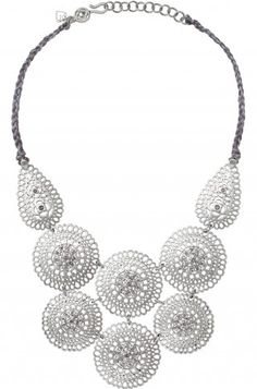 MEDINA BIB NECKLACE A bold cluster of silver plated medallions boast intricate filigree, hand set crystal and a braided metallic, silk thread