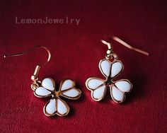 Fashion Clover EarringsMaterial: alloy, drip glazeSpecifications: Clover 2cm, earrings total length 4cm (containing ear hook)Weight:7g/$16.99