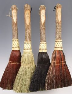 Multi colored hearth brooms with Tree Spirit or Green Man faces carved in the handles. I have a couple, and they are favorites. Broomchick via etsy. #brooms