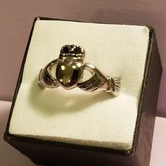 Irish Claddagh Titanium Steel Ring with a Black Accented Crown. We are now working with a supplier who sells to major jewelry stores! Why spend hundreds when you can get the same high quality and a fraction of the cost!  Multiple Sizes Available! Please visit us for more information