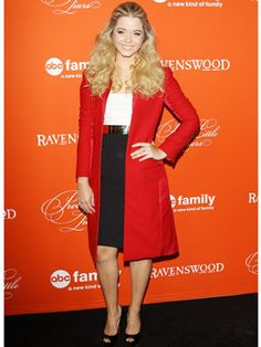 We're loving Sasha Pieterse's red coat on the Halloween episode premiere carpet!