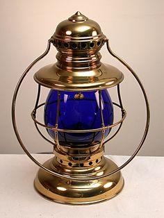 lantern with cobalt blue globe steam gauge and lantern company
