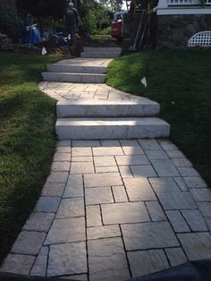 Tiered walkway using Techo-bloc Rocka steps with Mist three piece pavers with a Herra soldier. By Matt's Landscaping & Stonescaping LLC Queensbury, NY.