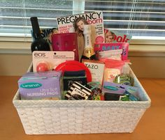 Gift basket ideas for new mom very cute besides the champagne....inappropriate especially if the mother is nursing