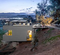#House in Reverse: Rooftop Driveway Leads to Hillside #Home