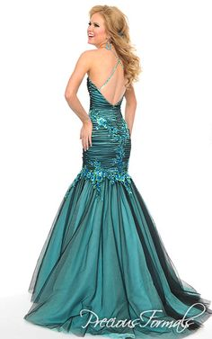 Precious Formals Style L21003 Jewels and sequins cascade from the middle of this strapless sweetheart neckline onto a bed of folded illusion down to the dropped waist on this dreamy mermaid gown.