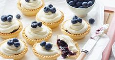Take a quick shortcut with these easy blueberry and cream tarts.