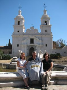 Carlota F. Haider, 81, (right) sits with her brother Marcelo A. Ferreyra, '83, and his wife, Beth, '09, during a family trip to visit the Jesuit mission and estancia of Santa Catalina in Córdoba, Argentina.