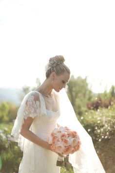 inspiration from the wedding day of Molly Sims | Moroccan blanket to stand on during the ceremony, hanging vases, rose head lined aisle, escort cards pegged to vines... dreamy