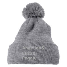 Angelica, Eliza, Peggy Knit Pom Cap is coming with cool design with multiple colors with Customon quality. This knit pom cap is all about angelica, eliza, peggy, hamilton, broadway, schuyler-sisters,