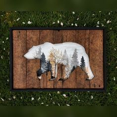 A beautiful cut out on reclaimed wood and pallets of a bear with the painting of a crisp and foggy autumn morning with shades of trees fading into the winter. Multiple sizes now available.