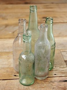 Vintage Medium Glass Bottles. http://www.freepeople.com/vintage-loves-waxing-poetic/vintage-medium-glass-bottles-26733923/