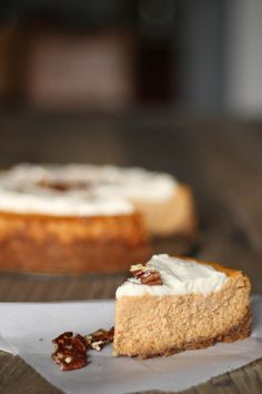 Creamy pumpkin cheesecake made with a nutty crust and topped with bourbon whipped cream