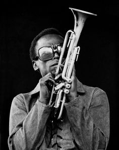 Miles to my knowledge was the first to do the upside down sunglasses look,