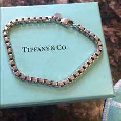 Authentic Tiffany & Co. Sterling Silver Bracelet! This Sterling Silver, Authentic, Bracelet from Tiffany & Co. Is in Excellent Condition, comes in original Blue Tiffany's Box, & is an ideal accessory for people of all ages and with various personal Styles. Its Simple yet Super Cool & Classy, Elegant, & Timeless, all while still Totally stylish!! Accepting all reasonable Offers!! So make one!! xoxo Tiffany & Co. Jewelry Bracelets