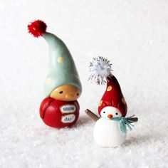 Holiday Gnome and Miniature Snowman- Christmas Clay Decorations- Handmade Winter Collectible Figurines by humbleBea on Etsy https://www.etsy.com/listing/113556087/holiday-gnome-and-miniature-snowman