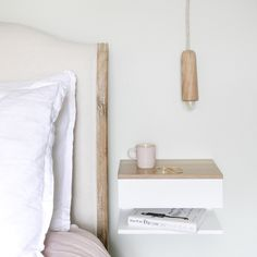 oak topped bedside with oak pendant light and bed