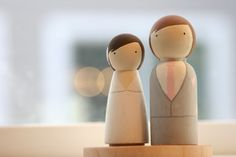@Kristján Örn Kjartansson Martinez, I don't know whst it is about these but I think they sre do damn cute. Customizable Wooden Peg Doll Cake Toppers by OrangeCrushSeattle, $40.00