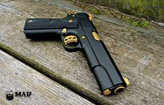 Cerakote Graphite Black and Gold 1911. These colors look fantastic together.!!!