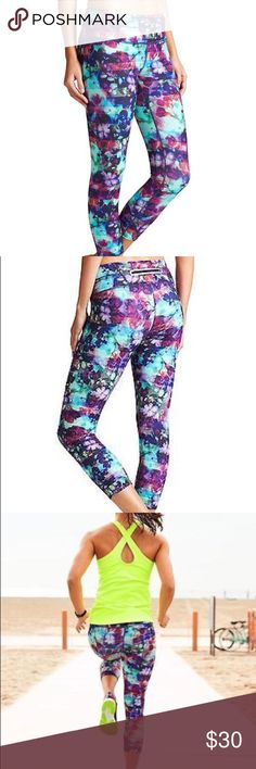 """Athleta Floral Fade Sonar Capris Performance-fitted, Mid-rise, Tight leg Sits two fingers below the navel, hugs the body for a performance edge Inseam: Regular: 20"""". Tall: 23"""" product details INSPIRED FOR: gym/training, run, studio workouts Ultra-comfortable wide waistband, hidden key pocket NEVEREND DRAWSTRING. Fully adjustable continuous loop never gets lost in the wash Reflective trim shines bright in low light, minimal seams reduce chafe Breathable CoolMax® crotch gusset Rear zip pocket…"""