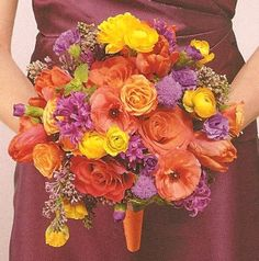 This bouquet combines orange roses against purple stock. Purple monte casino is used as a filler with touches of green ivy.