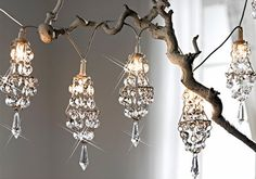 mini chandeliers with beads and wire... just an idea, bet this would be fun!