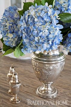 Blue hydrangeas in a vintage silver vase are at the same time casual and stylish. - Photo: Paige Rumore